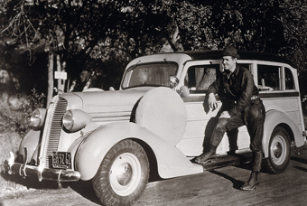 Gable with 1937 Ford station wagon